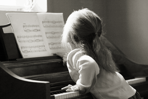 black and white piano student